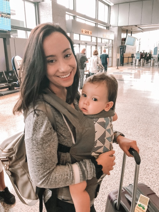 Arriving at the airport. We always opt to carry Emerson in a carrier and check his stroller right away, just because it's easier to navigate the airport. Plus, I think he feels more comfortable with us than in his stroller.